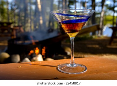 Martini by a campfire helping to keep warm on a cool spring evening.