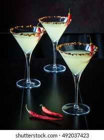 Martini with Chili Peppers on Black Background