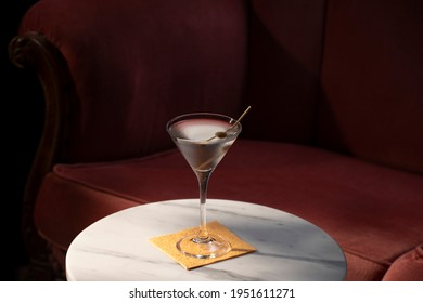 Martini cocktail, with gin and vermut dry; garnished with olive