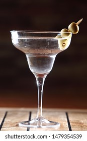 The martini is a cocktail made with gin and vermouth, and garnished with an olive or a lemon twist. Over the years, the martini has become one of the best-known mixed alcoholic beverages.