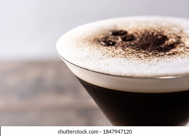Martini espresso cocktail in glass on wooden table.Close up - Shutterstock ID 1847947120