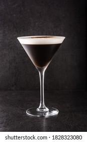 Martini espresso cocktail on black background