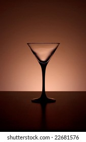 Martini glass back light, elegant composition, space for text
