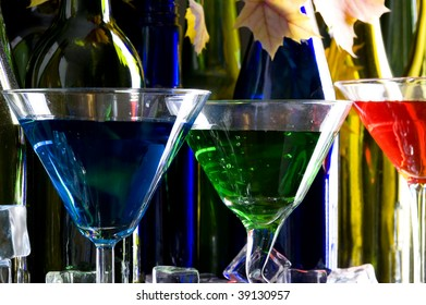 Martini glass and colored bottles