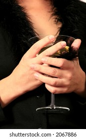 martini glass cup in woman hands