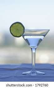 A martini glass with a lime slice on the rim