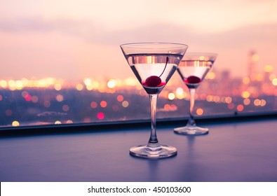 Martini glasses on a bar. City night life concept.