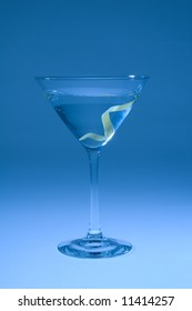 Martini with lemon twist shifted blue for artistic effect.