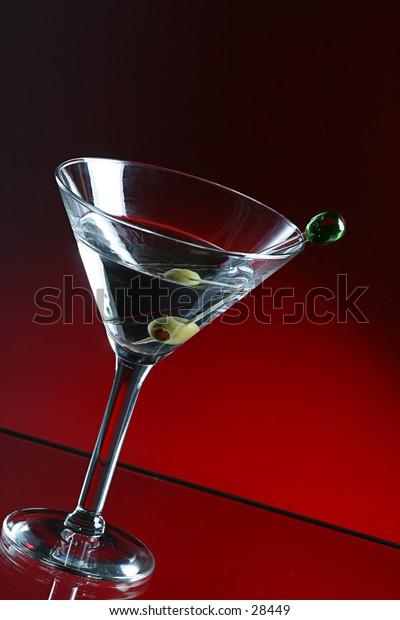 Martini  and olive in martini  glass.