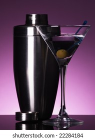 Martini and shaker on purple background
