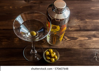 martini and shaker of wooden background