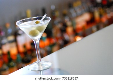 Martini sitting on bar with Bokeh background.