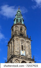 Martini tower (Martinitoren) in Groningen, Holland, with a blue sky and some white clouds.