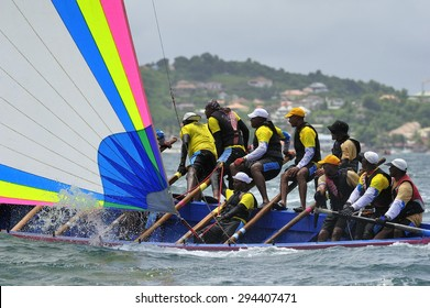 Martinique, Caribbean Sea - August .5. 2011 :  Yoles Boat Race, traditional sailing regatta around the ocean in Martinique, using the vessels with rectangular sails, Martinique, Caribbean Sea