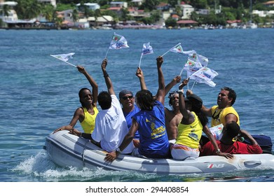 Martinique, Caribbean Sea � August .5. 2011 : spectators cheer Yoles Boat Race,  traditional regatta around the ocean in Martinique, using the vessels with rectangular sails, Martinique, Caribbean Sea