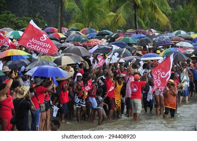 Martinique, Caribbean Sea � August .5. 2011 :  crowd to cheer Yoles Boat Race,  traditional regatta around the ocean in Martinique, using the vessels with rectangular sails, Martinique, Caribbean Sea