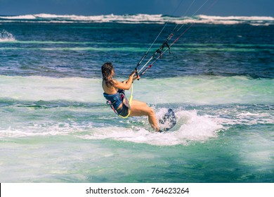 Martinique, Caribbean : a woman is kitesurfing