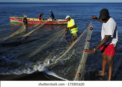 MARTINIQUE - March 13 2011 :  A group of fishermen catching fish with the net, the traditional way of fishing at the small fishing village along west coast of Martinique, Caribbean Sea