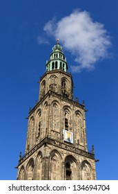 Martini-tower (Martinitoren) in Groningen with a blue sky and white clouds on a nice day in spring.