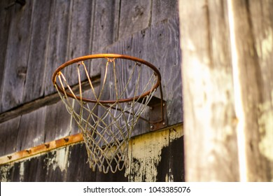 Martinsburg, WV / USA - March 10, 2018: A basketball hoop remains hung on the side of an abandoned barn in Martinsburg, WV, winter of 2018