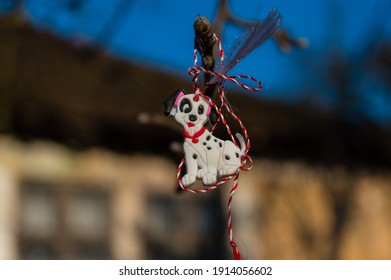 Martisor, symbol of the beginning of spring. March 1 traditional trinket.  Puppy martisor with red white thread