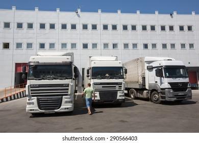 "MARTUSIVKA, UKRAINE - JUNE, 25, 2015: Trucks in the territory of custom post ""East Terminal"" (Kiev Customs Service of State Fiscal Service of Ukraine) near Kiev"