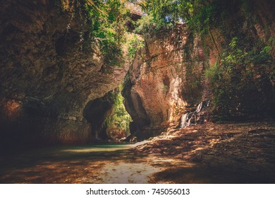 Martvili canyon in Georgia. Beautiful canyon with waterfall in rock and mountain river. Place to visit. Nature landscape. Travel background. Holiday, sport, recreation. Vintage retro toning filter