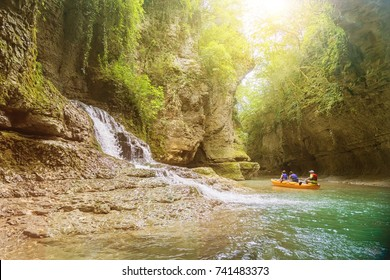 Martvili, Georgia - August 20, 2017: A group of tourists floating in a rubber boat on the river canyon