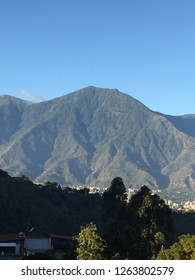 A  marvellous mountain with a diferent tones of green color in the top of this a beautiful blue skay