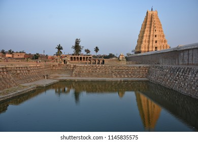Marvellous reflection of lofty Eastern Gopura(160 ft high) of Virupaksha temple on the near by temple pond (Pushkarani) - Hampi, Karnataka.