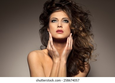 marvelous beautiful brunette posing in the studio - hair styling concept