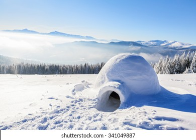 Marvelous huge white snowy hut, igloo  the house of isolated tourist is standing on high mountain far away from the human eye