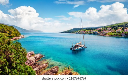 Marvelous summer view of Fiskardo port. Stunning morning seascape of Ionian Sea. Picturesque morning scene of Kefalonia island, Greece, Europe. Traveling concept background.