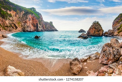 Marvelous summer view of Gyali beach. Amazing morning seascape of Ionian Sea. Fantastic outdoor scene of Corfu island, Greece, Europe. Beauty of nature concept background.