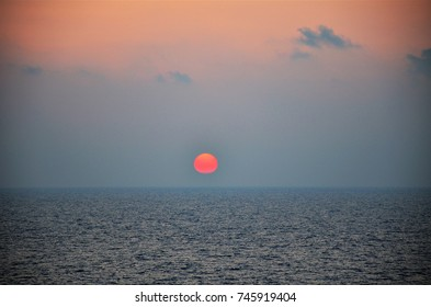 Marvels sunset on the high seas with sky in shades of pink, blue and lilac.