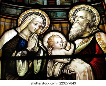 Mary, Joseph and the Christ child in stained glass