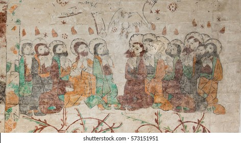 Mary Magdalene is among the twelve apostles and they have Tongues of Fire over their heads on Whit Sunday, a fresco painting at Aarhus cathedral, Denmark, June 21, 2015,