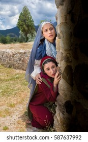 Mary and Mary Magdalene standing at the entrance of the empty tomb of Jesus on Easter morning