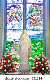 Mary Statue and Stained glass Inside Interior a Catholic Church, Assumption University, Thailand