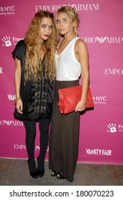 Mary-Kate Olsen, Ashley Olsen, carrying a Bottega Veneta bag, at The 7th Annual Free Arts NYC Art & Photography Benefit Auction, Phillips de Pury Company Gallery, New York, May 23, 2006