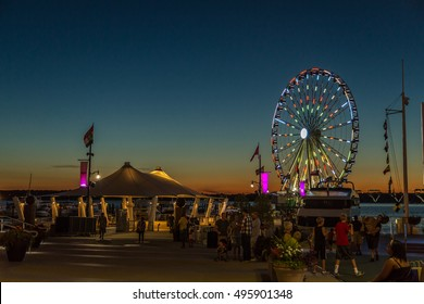 Maryland, Aug 28: People enjoy a beautiful summer evening at the National Harbour in Maryland, USA -  August 28, 2014.
