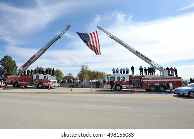 Maryland Heights, MO, USA - October 13, 2016: Police, firemen and civilians wait on an overpass to show respect to fallen police officer Blake Snyder, who died in the line of duty.