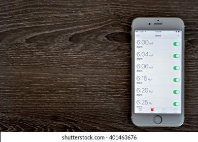 MARYLAND, USA - APRIL 5, 2016: An Apple iPhone 6s displaying the alarm clock application. The Apple iPhone 6s is a product of Apple Inc.
