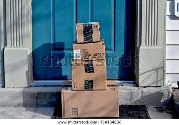MARYLAND, USA - January 18, 2016: Image of an Amazon package. Amazon is the largest Internet-based retailer in the United States.