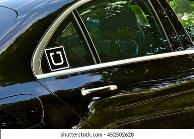 MARYLAND, USA - JULY 12, 2016: A luxury Mercedes-Benz being used as an Uber transportation vehicle. Uber Technologies Inc. is an American multinational online transportation network company.