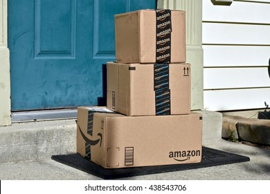 MARYLAND, USA - JUNE 17, 2016: Amazon Prime boxes delivered to the front door of a home. Amazon is the largest Internet-based retailer in the United States.