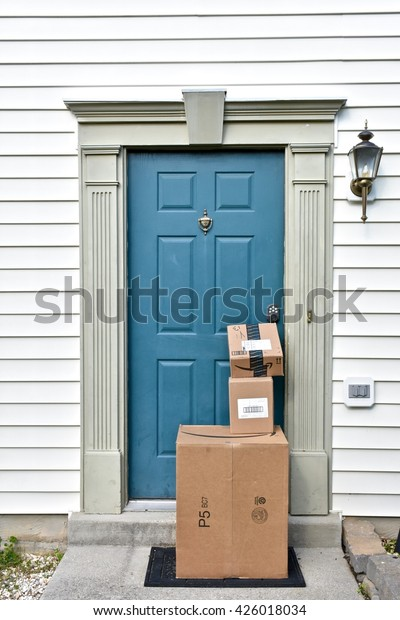MARYLAND, USA - MAY 24, 2016: Amazon boxes delivered to a residential home. Amazon is the largest internet based retailer in the United States.