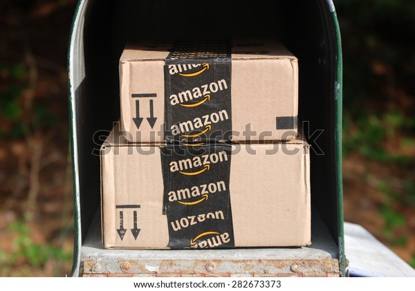 MARYLAND, USA - MAY 29, 2015: Image of an Amazon packages. Amazon is an online company and is the largest retailer in the world.