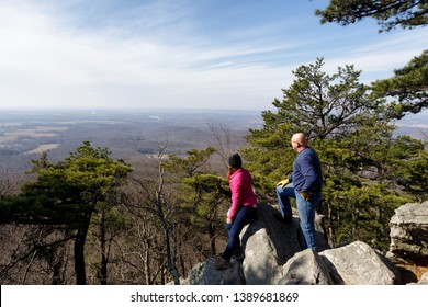 Maryland,USA - February 16, 2019: Two people admiring the view from the peak of the Sugarloaf Mountain in Maryland