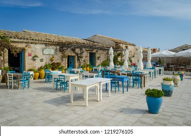 Marzamemi, Italy – October 10 2018: The picturesque village of Marzamemi one of the most beautiful 20 sea villages of Italy in the province of Syracuse, Sicily.One of the restaurant in the main square